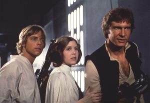In this 1977 image provided by 20th Century-Fox Film Corporation shows, from left, Harrison Ford, Carrie Fisher, and Mark Hamill in a scene from Star Wars.