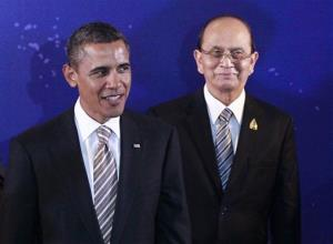 In this Nov. 19, 2011, file photo US President Barack Obama stands with Burma President Thein Sein during a group photo session at the East Asia Summit in Nusa Dua, on the island of Bali, Indonesia.