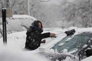 A woman clears snow from her parked car Wednesday, Nov. 7, 2012, in Dover Township, N.J., as the region pounded by Superstorm Sandy last week is hit by a Nor'Easter.  Gov. Chris Christie warned Wednesday that New Jersey may suffer a setback in its Superstorm Sandy recovery efforts as...