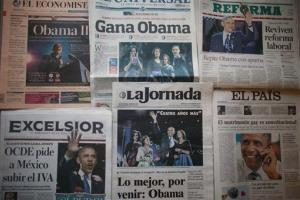 Mexican newspapers carry front page photos and stories about the US presidential election and President Barack Obama's re-election, Wednesday, Nov. 7, 2012.
