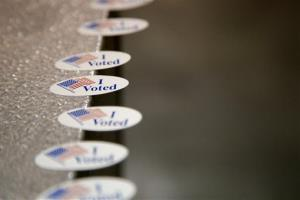 I Voted stickers are seen at a polling place in Billings, Mont., Tuesday, Nov. 6, 2012.
