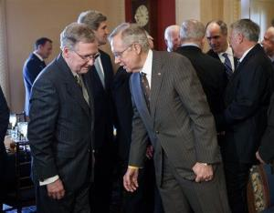 Senate Majority Leader Harry Reid, right, and Minority Leader Mitch McConnell confer on Capitol Hill in this file photo.