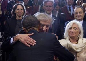 President Barack Obama embraces Elie Wiesel as Wiesel's wife, Marion Erster Rose watches ar right, after Obama spoke at the Holocaust Memorial Museum in Washington, Monday, April 23, 2012.