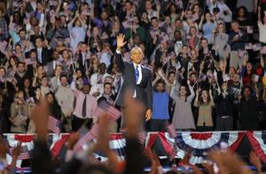President Obama waves after delivering his victory speech to supporters gathered in Chicago early Wednesday.
