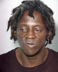 This image released by the Las Vegas Police Department shows rapper Flavor Flav, also known as William Jonathan Drayton, Jr., in a police booking photo taken Oct. 17, 2012.