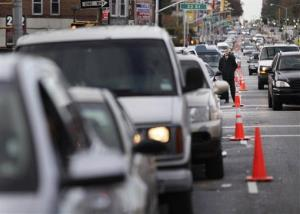 In this Nov. 2 file photo, cars wait for gas in Brooklyn.
