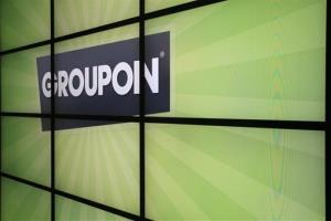 This Oct. 21, 2011 file photo shows the Groupon logo inside the online coupon company's offices, in Chicago.