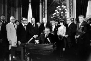 In this Aug. 6, 1965, photo, President Lyndon Baines Johnson signs the Voting Rights Act into law.