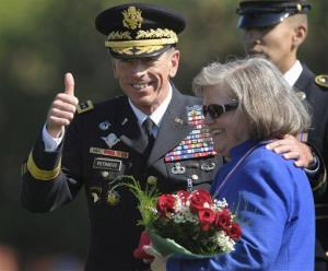 In this Aug. 31, 2011, file photo, Gen. Davis Petraeus is seen with his wife, Holly.