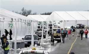 People walk along rows of large tents Thursday, Nov. 8, 2012, in Oceanport, in Monmouth County, NJ.