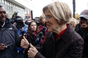 Massachusetts Senator-elect Elizabeth Warren arrives to greet commuters and thank Massachusetts residents, Wednesday, Nov. 7, 2012, in Boston.