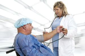 A doctor looks at an overweight patient.