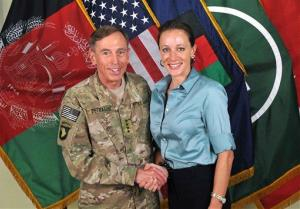 Davis Petraeus, left, shaking hands with Paula Broadwell, on July 13, 2011.