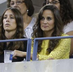 Pippa Middleton, right, watches the quarterfinal between Roger Federer, of Switzerland, and Tomas Berdych, of the Czech Republic, at the US Open tennis tournament Sept. 5, 2012, in New York.