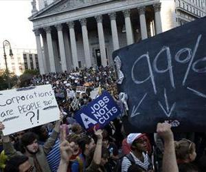 In this Oct. 5, 2011 file photo, Occupy Wall Street protesters join a labor union rally in Foley Square before marching on Zuccotti Park in New York's Financial District.