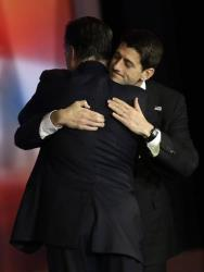 Mitt Romney embraces Paul Ryan after Romney conceded the race during his election night rally, Wednesday, Nov. 7, 2012, in Boston.