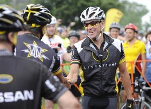 This Aug. 22, 2010 file photo shows Lance Armstrong, center, greeting fellow riders prior to the start of his Livestrong Challenge 10K ride for cancer in Blue Bell, Pa.