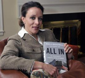 In this Jan. 15, 2012 photo, Paula Broadwell, author of the David Petraeus biography All In, poses for photos in Charlotte, NC.