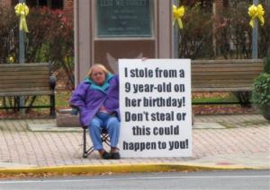 In this 2009 file photo, Evelyn Border holding a sign in front of the Bedford County courthouse in Bedford, Pa.