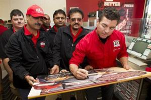 COMMERCIAL IMAGE In this photograph taken by AP Images for Papa John's, Papa John's Founder, Chairman, and CEO John Schnatter autographs an illustration.