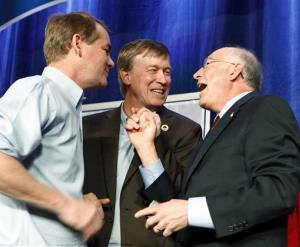 U.S. Sen. Michael Bennet, left, Gov. John Hickenlooper and U.S. Interior Secretary Ken Salazar celebrate after President Barack Obama was predicted the winner over Mitt Romney at a Colorado Democrat's election party at the Sheraton Hotel in Denver on Tuesday, Nov. 6, 2012.