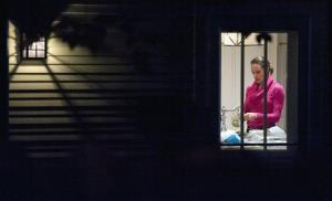 Paula Broadwell is visible through the window in the kitchen of her brother's house in Washington, Tuesday, Nov. 13, 2012.