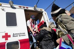 A member of the Red Cross distributes food to residents of Coney Island affected by Superstorm Sandy in the Brooklyn borough of New York on Friday, Nov. 9, 2012.