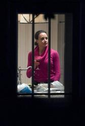 Paula Broadwell holds a drink in the kitchen of her brother's house in Washington, Tuesday, Nov. 13, 2012.