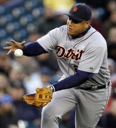 Detroit Tigers third baseman Miguel Cabrera flips the ball from the glove to his hand after fielding a grounder.