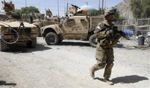 This June 19, 2012 file photo shows a US soldier, part of the NATO forces, patrolling a police station in Kandahar, south of Kabul, Afghanistan.