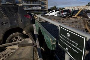 Hundreds of feet from the beach, a large section of the boardwalk is entangled with vehicles in the Rockaway Park section of the borough of Queens, New York, Monday, Nov. 5, 2012, in the wake of Superstorm Sandy.