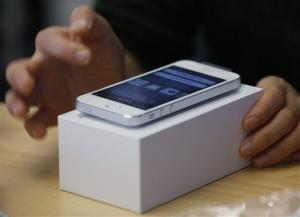 A customer tests the new iPhone 5 at the Apple store in Hong Kong Friday, Sept. 21, 2012.