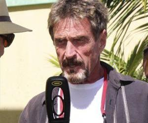 In this Nov. 8, 2012 photo software company founder John McAfee speaks at the official presentation of equipment ceremony that took place at the San Pedro Police Station in Ambergris Caye, Belize.