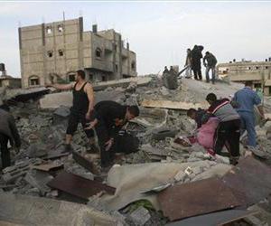 Palestinians inspect the rubble of the destroyed house of Hamas militant Mohammad Abu Shmala, following an Israeli air strike in Rafah, southern Gaza Strip, Friday, Nov. 16, 2012.