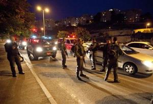Israeli security forces search for a rocket thought to have been fired by Palestinian militants from the Gaza Strip in Jerusalem Friday.