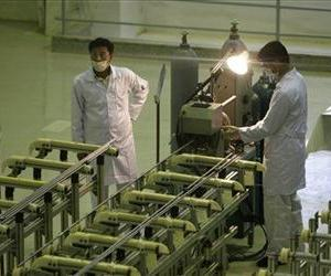 In this 2009 file photo, Iranian technicians work at a new facility producing uranium fuel for a planned heavy-water nuclear reactor, just outside the city of Isfahan.
