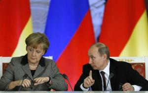 Russian President Vladimir Puti speaks to German Chancellor Angela Merkel in Moscow Friday.