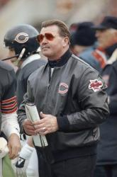1990: Chicago Bears head coach Mike Ditka stands on the sidelines during a game.