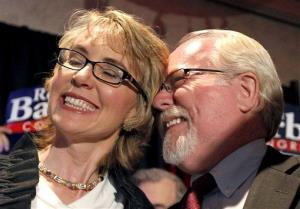 Ron Barber celebrates with Gabby Giffords in June after winning a special election to serve out her term. He has just won a full term.