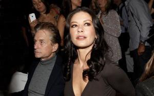 Michael Douglas and Catherine Zeta-Jones attends the Michael Kors Spring 2013 Runway Show on Wednesday, Sept. 12, 2012 in New York.