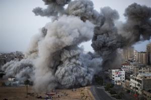 Smoke rises after an Israeli forces strike in Gaza City, Sunday, Nov. 18, 2012.