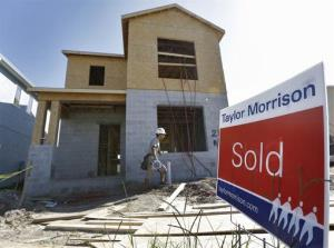 In this Wednesday, Sept. 26, 2012, file photo, a sold sign sits out in front of a home in Riverview, Fla.