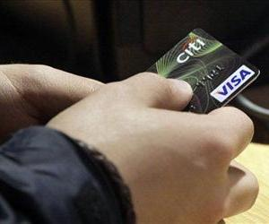 A Visa credit card is tendered at opening of the Superdry store in New York's Times Square.