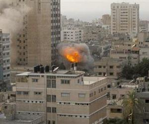 Smoke and fire are seen from an explosion by a high rise housing media organizations in Gaza City, Monday, Nov. 19, 2012.