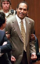 OJ Simpson clenches his fists in victory after the jury acquitted him in the murders of Nicole Brown Simpson and Ronald Goldman in this, Oct. 3, 1995, file photo in Los Angeles.
