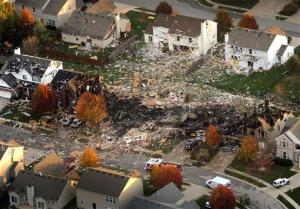 This aerial file photo from Nov. 11, 2012,  shows the two homes that were leveled and the numerous neighboring homes that were damaged from the  massive explosion in Indianapolis.