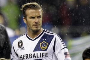 Los Angeles Galaxy's David Beckham appears on the pitch before their MLS Western Conference championship soccer match against the Seattle Sounders on Sunday.
