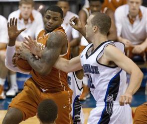 Texas forward Jaylen Bond, left, gets a rebound away from Chaminade forward Mike Green, right, during the first half of the game Monday, Nov. 19, 2012, in Lahaina, Hawaii.