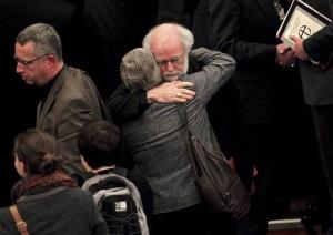 The outgoing Archbishop of Canterbury, Rowan Williams, embraces an unidentified person after the vote failed. Williams supports the idea of female bishops.