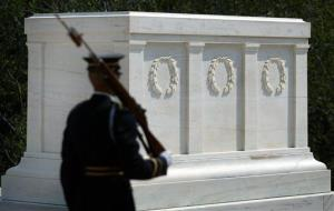 In this file photo, a guard stands watch over the Tomb of the Unknown Soldier in Arlington National Cemetery. The offending photo comes next.